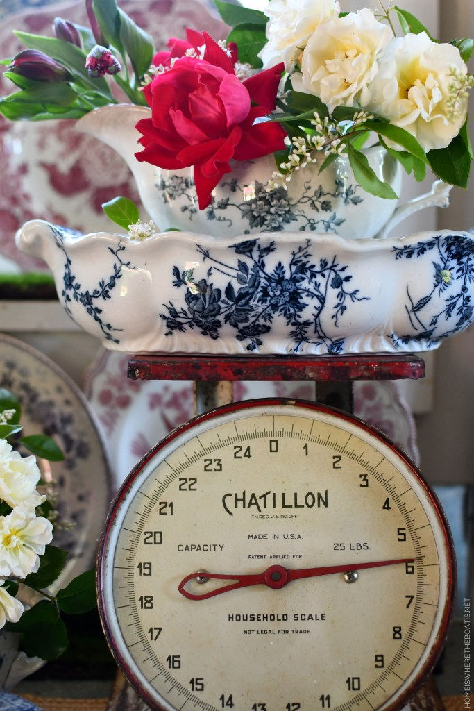 Red, White and Blue tablescape with vintage scale, transferware and flowers | ©homeiswheretheboatis.net #redwhiteandblue #transferware #flowers #tablescape #memorialday