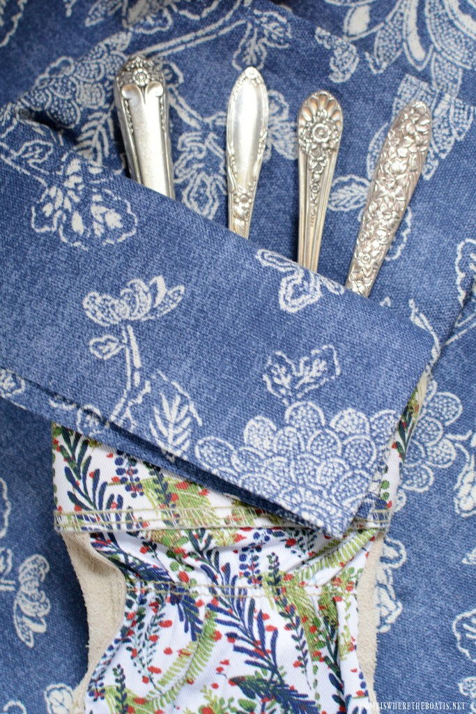 Garden gloves holding vintage flatware for table in Potting Shed | ©homeiswheretheboatis.net #redwhiteandblue #transferware #flowers #tablescape #memorialday