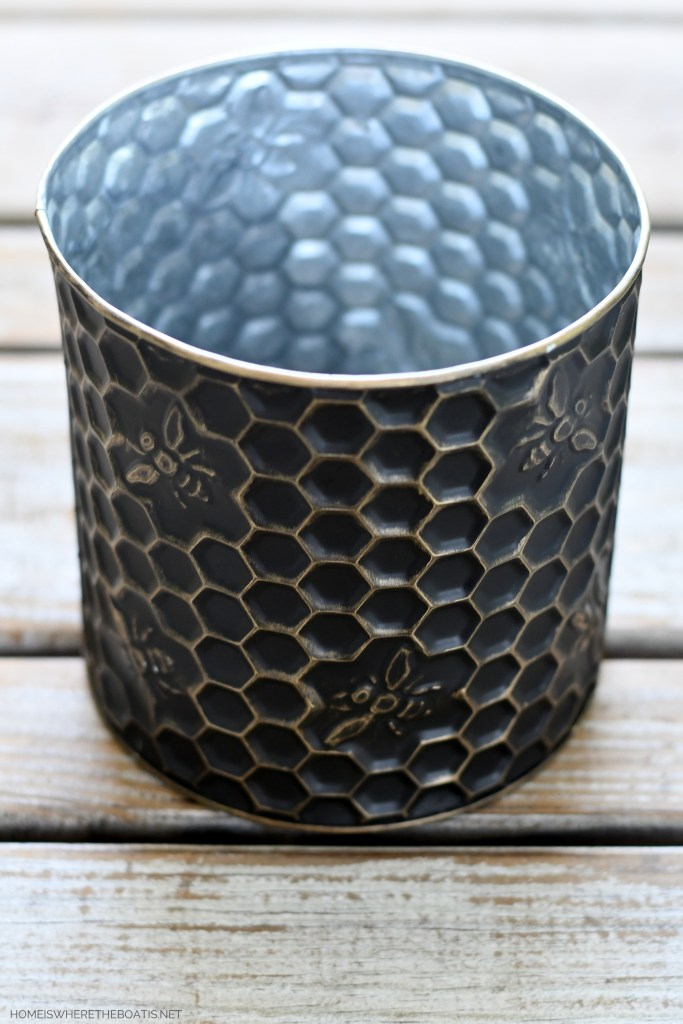 Metal embossed honeycomb and bee container for flower arrangement | ©homeiswheretheboatis.net #flowers #DIY #tablescape #bees #sunflowers #summer