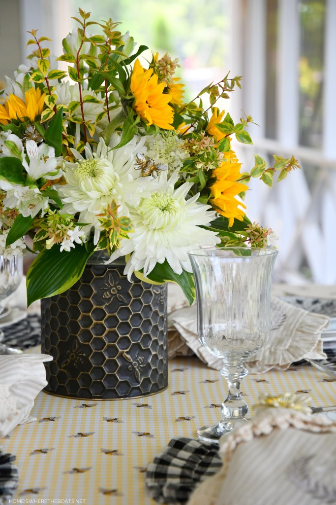 Buzzing with Bees: DIY Flower Arrangement and Summer Tablescape | ©homeiswheretheboatis.net #flowers #DIY #tablescape #bees #sunflowers #summer