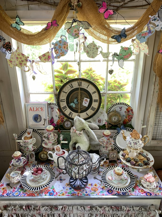 Teapot garland for Alice in Wonderland inspired table and Mad Tea Party | ©homeiswheretheboatis.net #teaparty #aliceinwonderland #tablescape