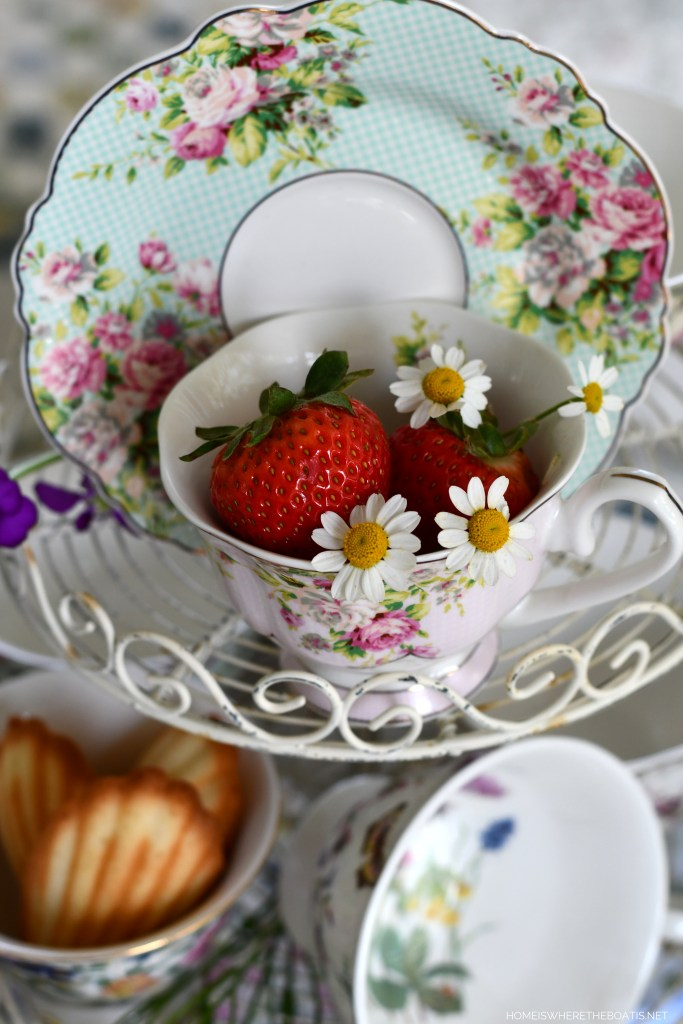Tea on the porch and tea cups on wire stand | ©homeiswheretheboatis.net #teatime