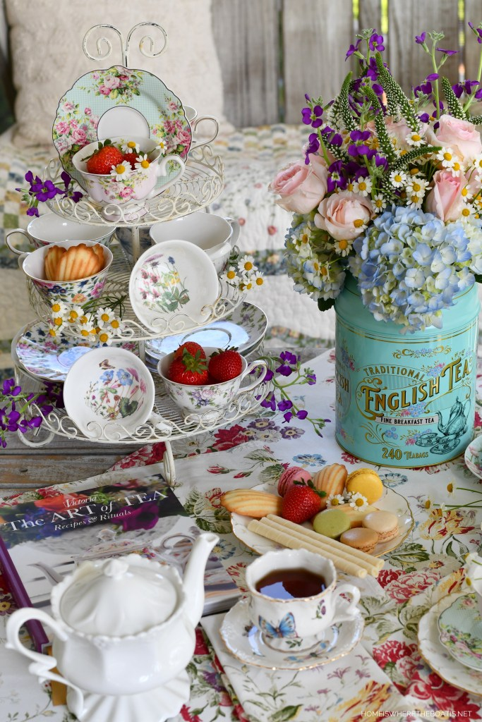Tea on the porch and tea cups on wire stand | ©homeiswheretheboatis.net #tea #flowerarrangement