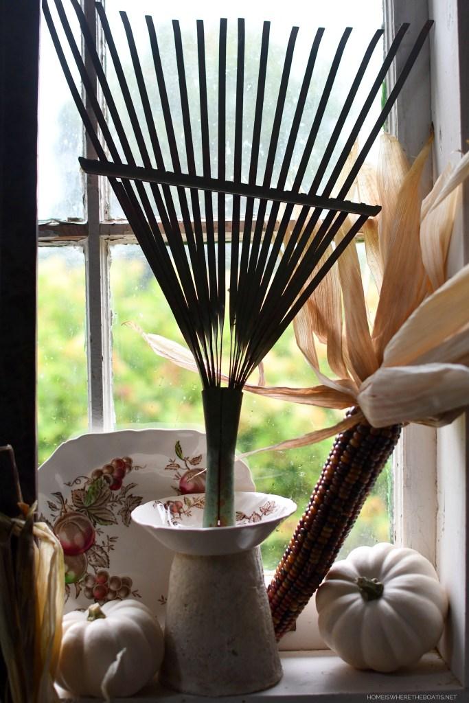 Vintage garden tools and harvest display in the Potting Shed | ©homeiswheretheboatis.net #garden #fall #harvest #tablescape #pottingshed