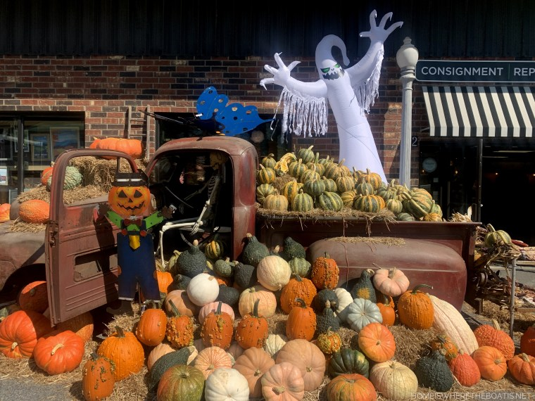 Pumpkin display with old truck, ghost, skeleton, scarecrow | ©homeiswheretheboatis.net #pumpkins #fall #halloween