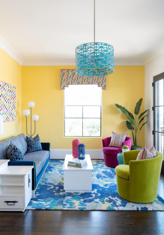 A room with a colorful window valence that is not out of style.