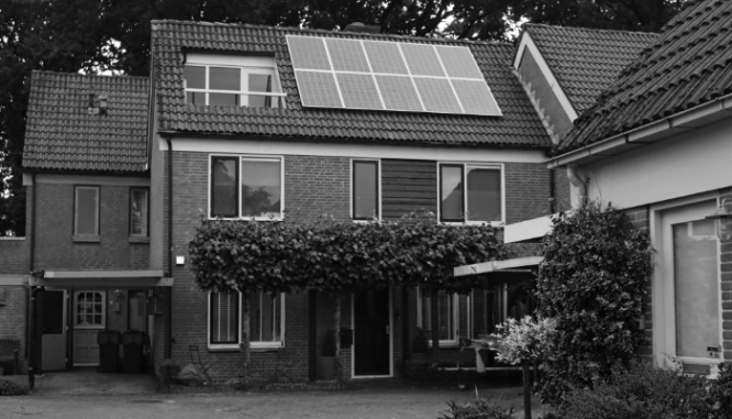 A house with solar panels and improved energy efficiency.