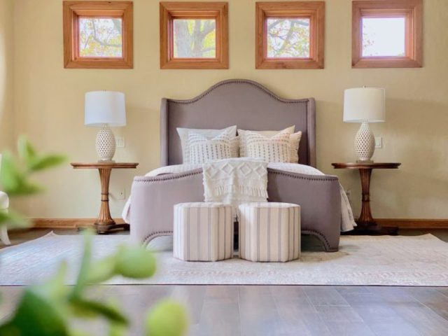 A bedroom that has an updated style.