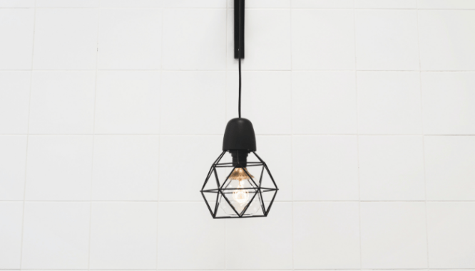A hanging light fixture used in an open floor plan.