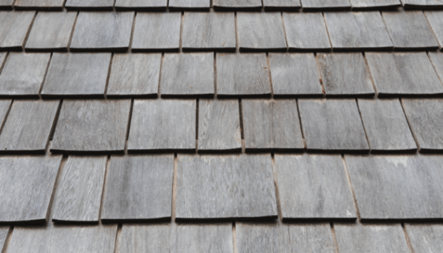 Roof shingles on a house to depict selling a rental property.