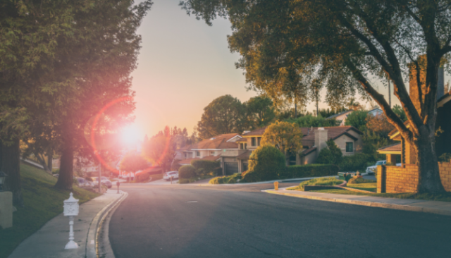 An image of a neighborhood with a sunrise to demonstrate what withdrawn means on an MLS listing.