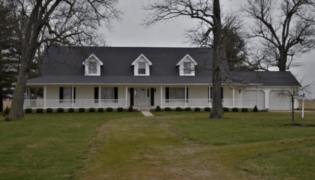 An image of a white and grey ranch house.
