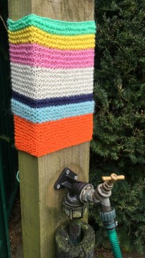 My Yarn Bomb decorating the water post