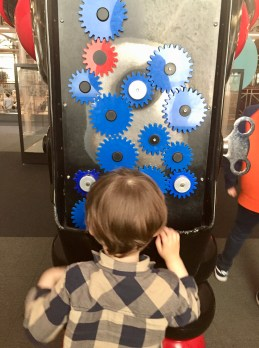 Interactive robot at Museum of Childhood, rearrange the cogs to light up the bulb