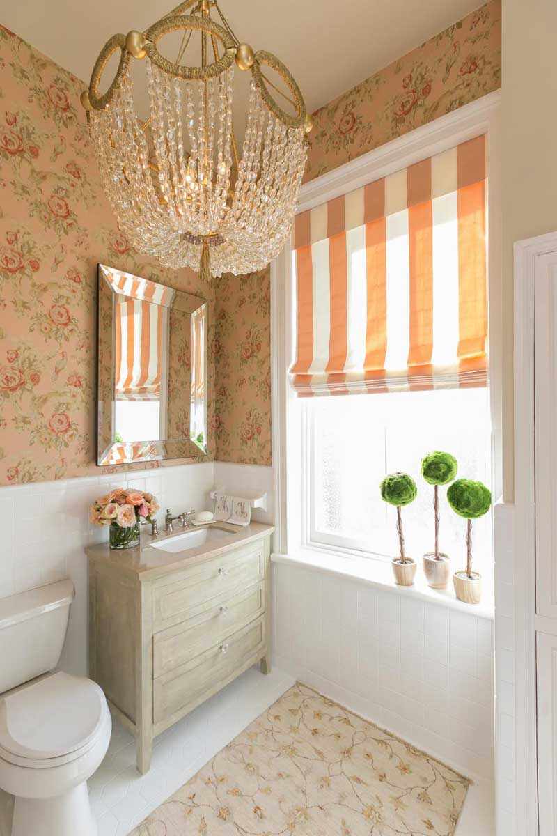 Bathroom With Chandelier And Floral Wallpaper