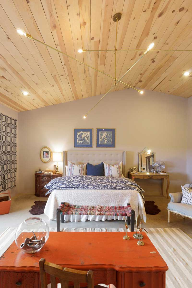 French Country Bedroom with Contemporary Brass Chandelier