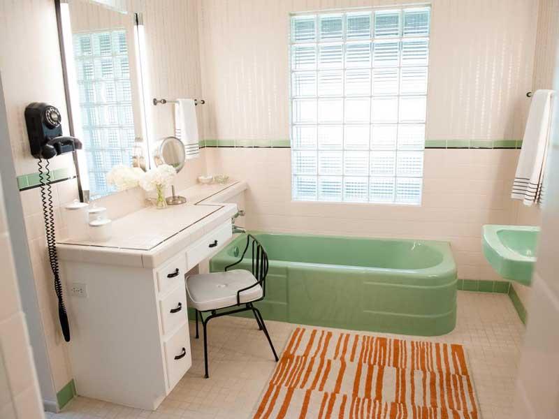 Midcentury Modern Bathroom with Green Tub