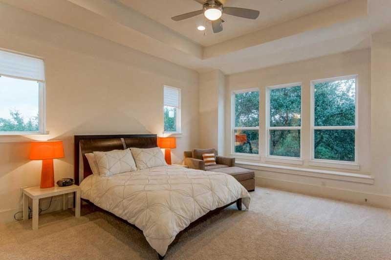 Modern Bedroom with Orange Bedside Lamps