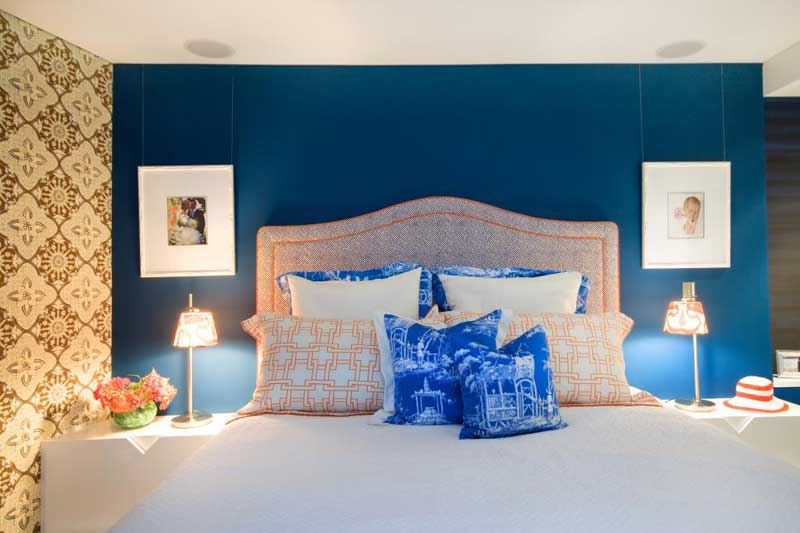 Blue and Orange Bedroom With Neutral Floral Wallpaper