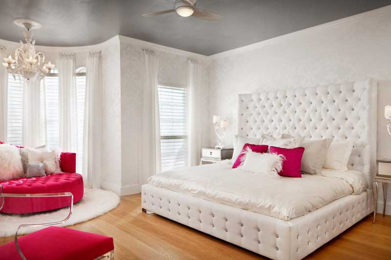 Glam Bedroom With White Tufted Bed