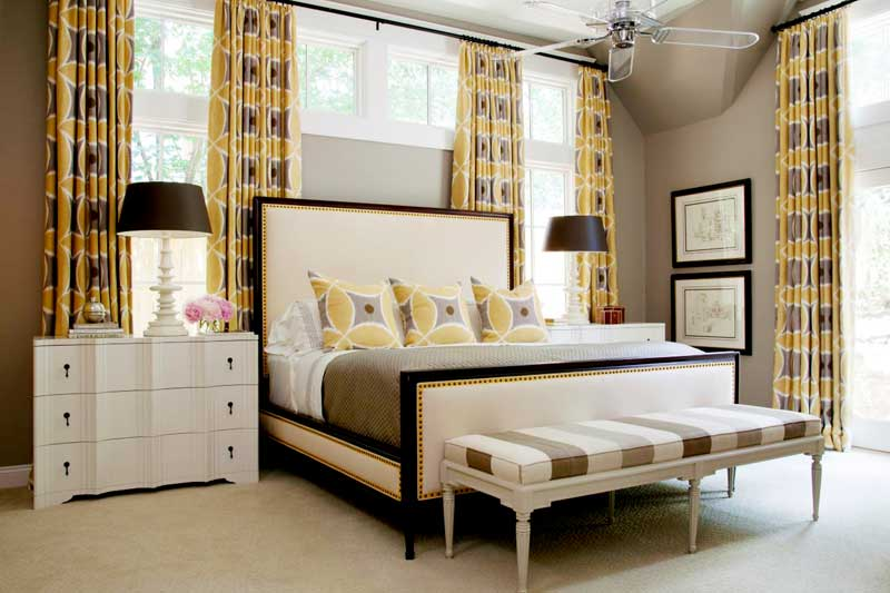 Gray and White Bedroom With Yellow Curtains
