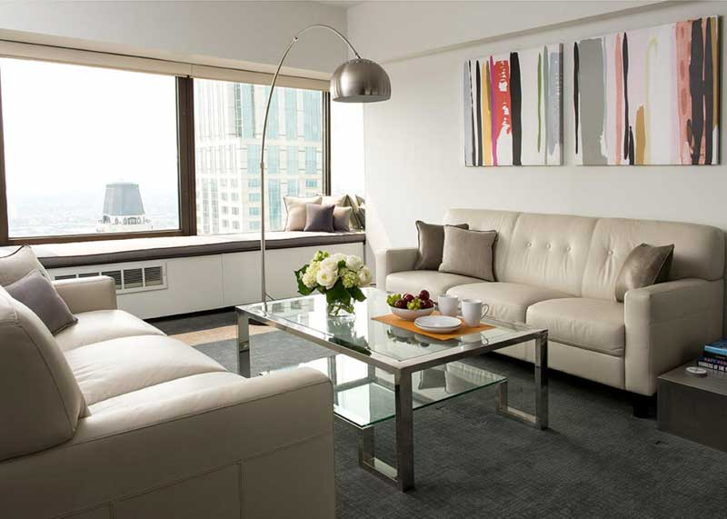 Modern White Living Room With Cream Leather Sofas