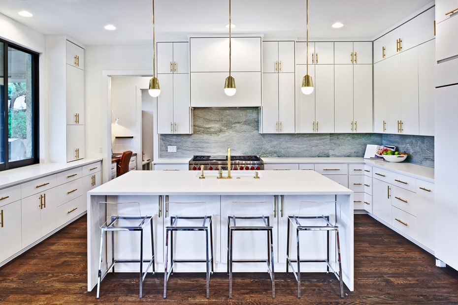 White Kitchen With Marble Tile Backsplash And Glass Bar Stools. Kitchen  With Mini Gold Pendant