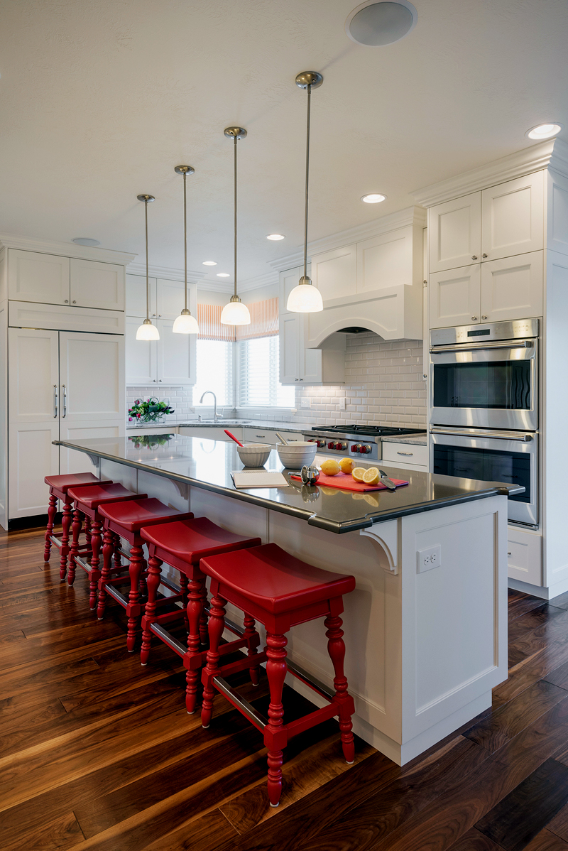 Wite Kitchen With Red Saddle Bar Stools. Kitchen With Mini Pendant Lights  Over White Kitchen
