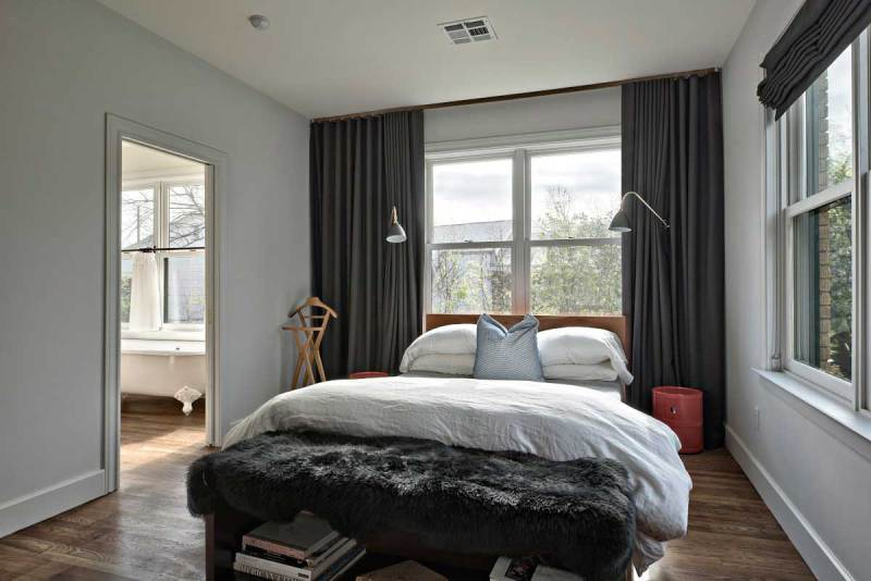 black bedroom with wall sconeces