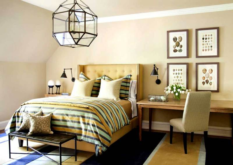 tan bedroom with cage lantern chandeliers