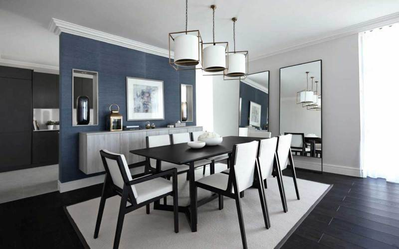 dining room with white drum pendant lights