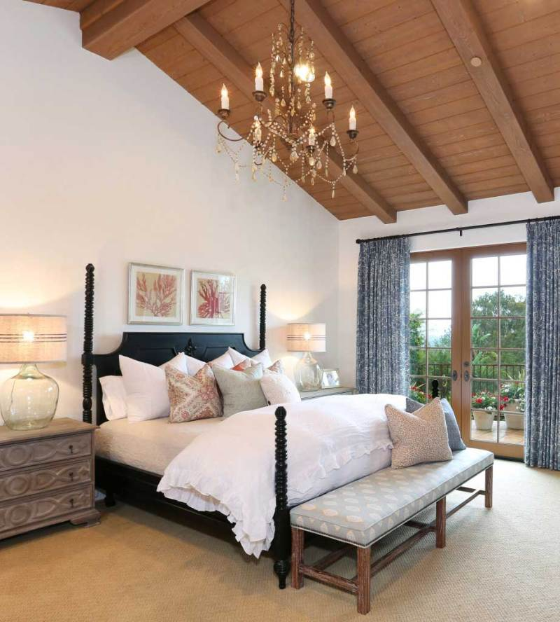 rustic bedroom with candle chandelier