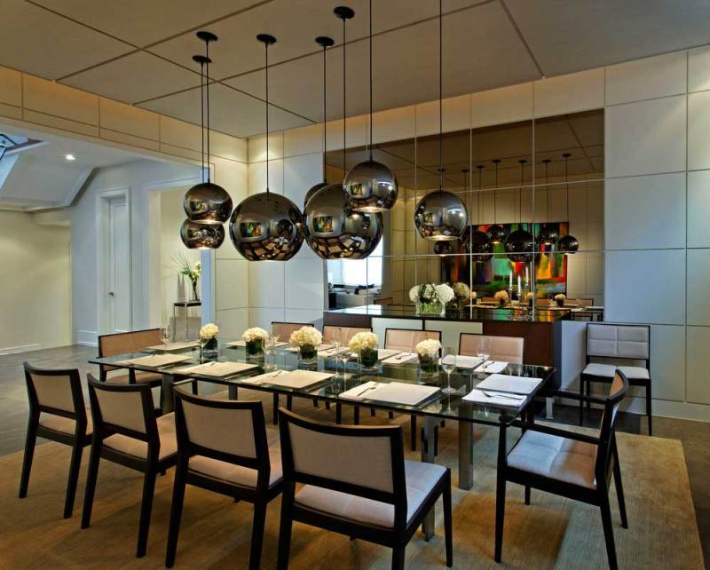 Modern Dining Room With Chrome Glass Globe Pendant Lights