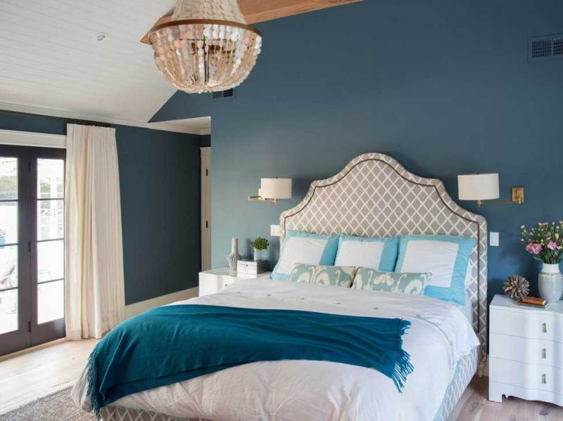 navy bedroom with wall sconeces