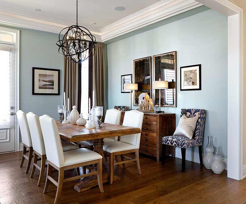 traditional dining room with orb crystal chandelier