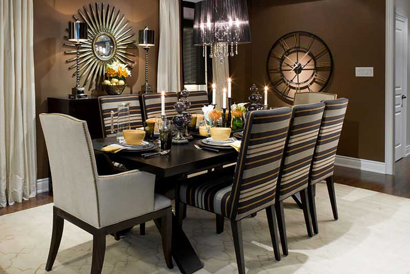 brown dining room with black drum chandelier and candle table lamps