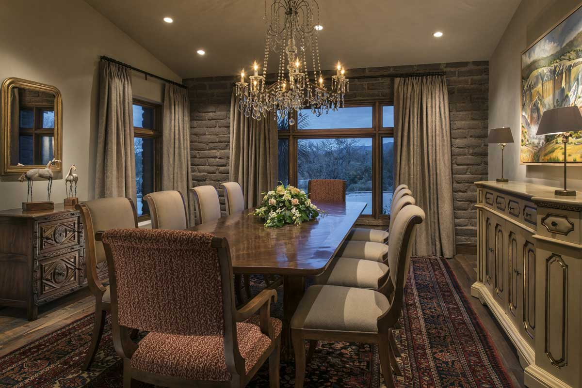 Rustic Dining Room With Glass Candle Chandelier And Table Lamps