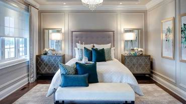 small master bedroom with drum crystal chandelier