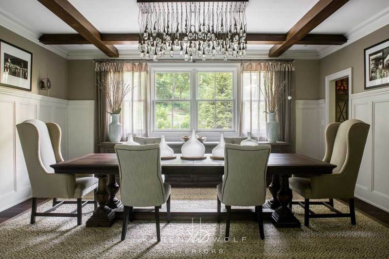 beige dining room with pendant lighting