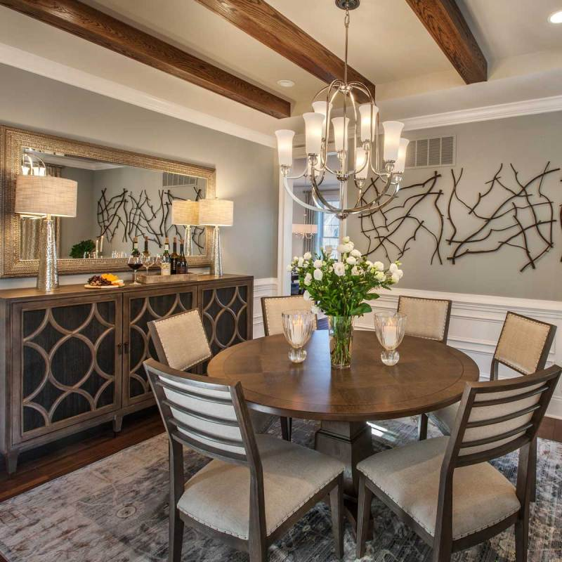small formal dining room with chandeliers