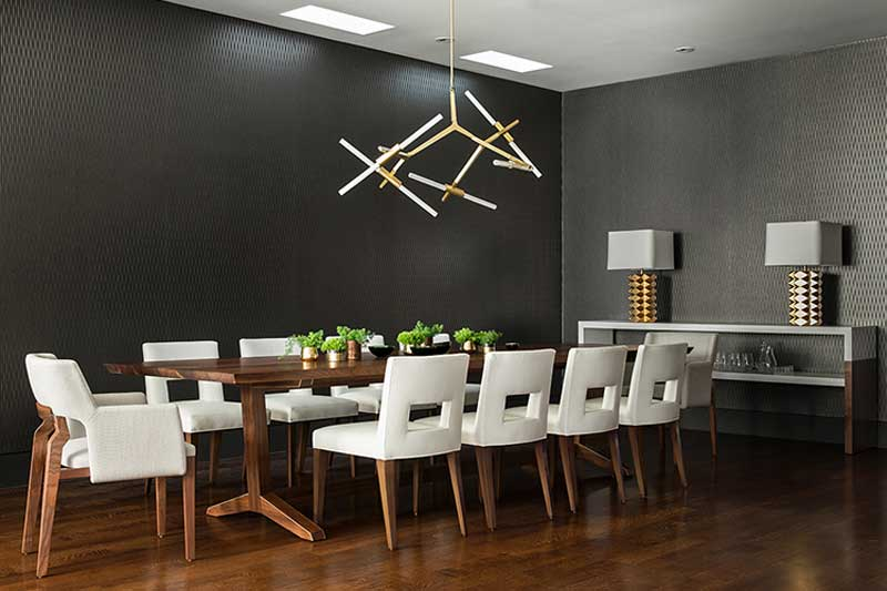 gray and white dining room with branch pendant light