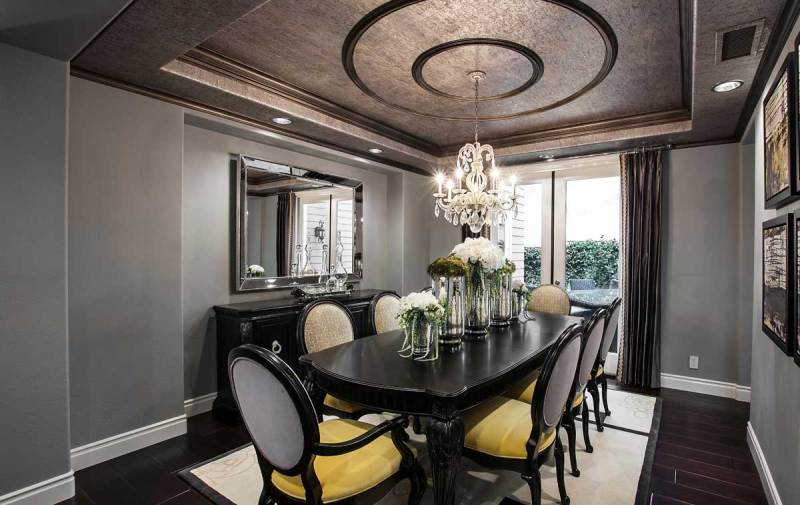 gray and black dining room with candle chandelier