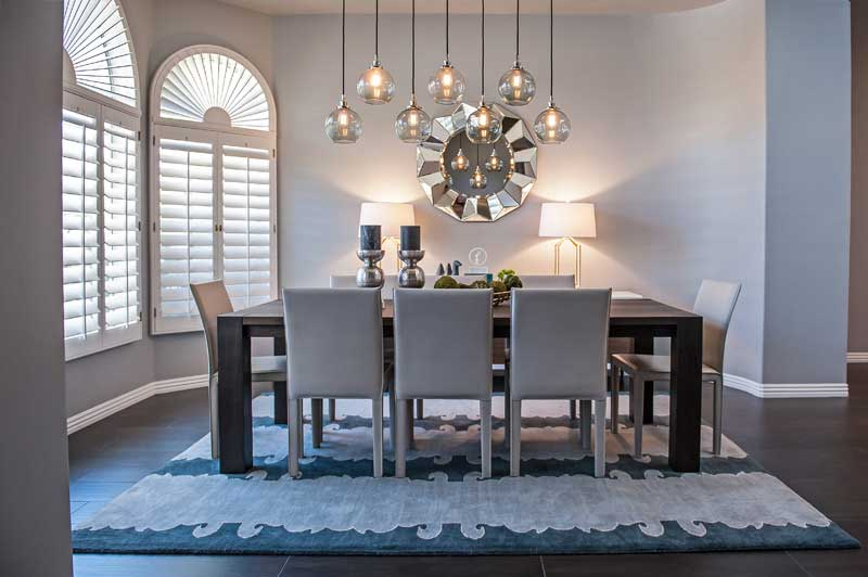 Contemporary Dining Room With Table Lamps And Glass Pendant Lights