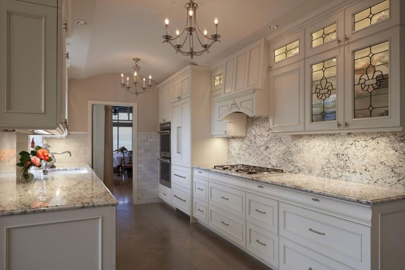 Kitchen with white cabinets and white ice granite countertops