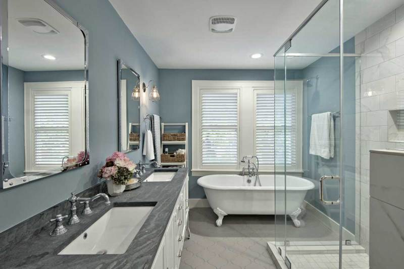 gray bathroom with clear glass wall sconces