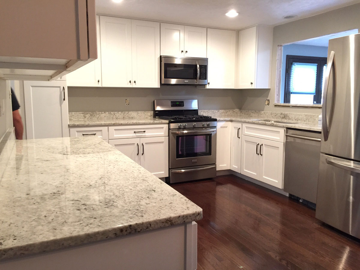 Superb Small White Kitchen With Colonial White Granite Countertops
