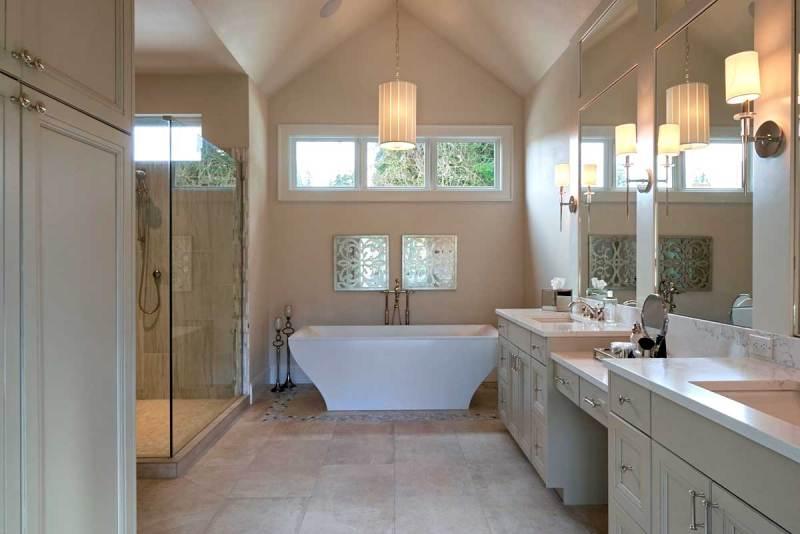 bathroom with wall sconces and pendant lighting.com
