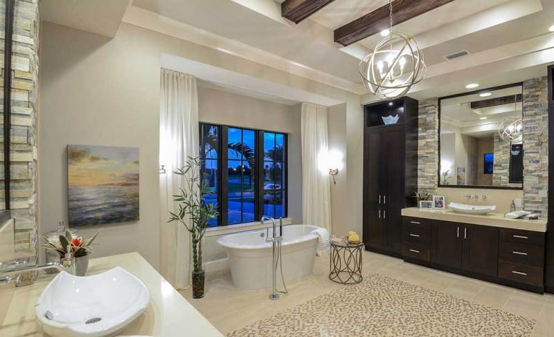 bathroom with orb chandelier