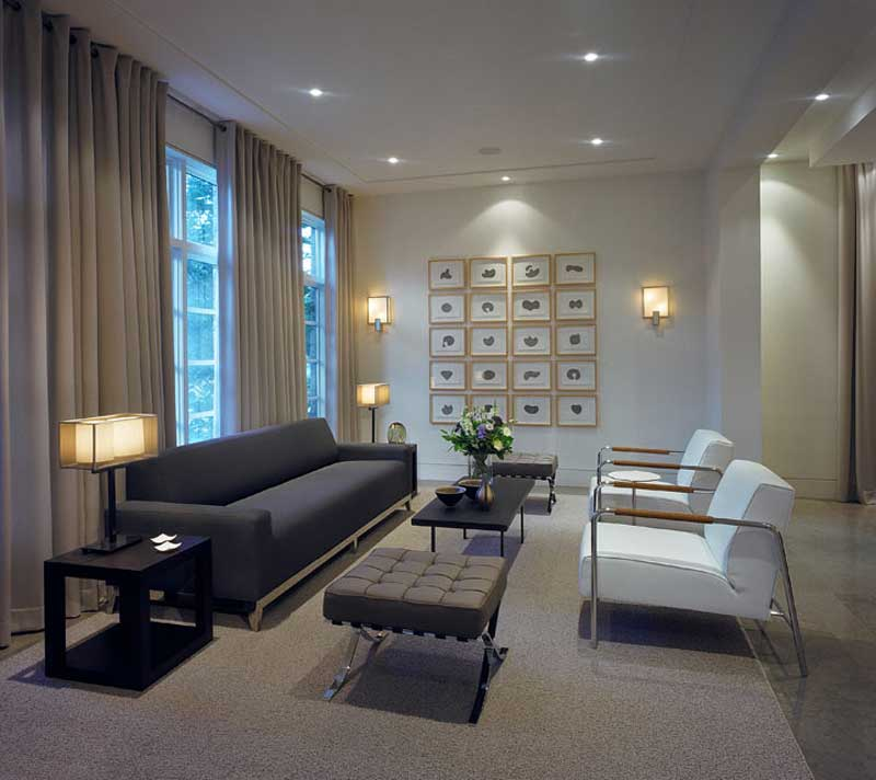 living room with wall sconces and table lamps