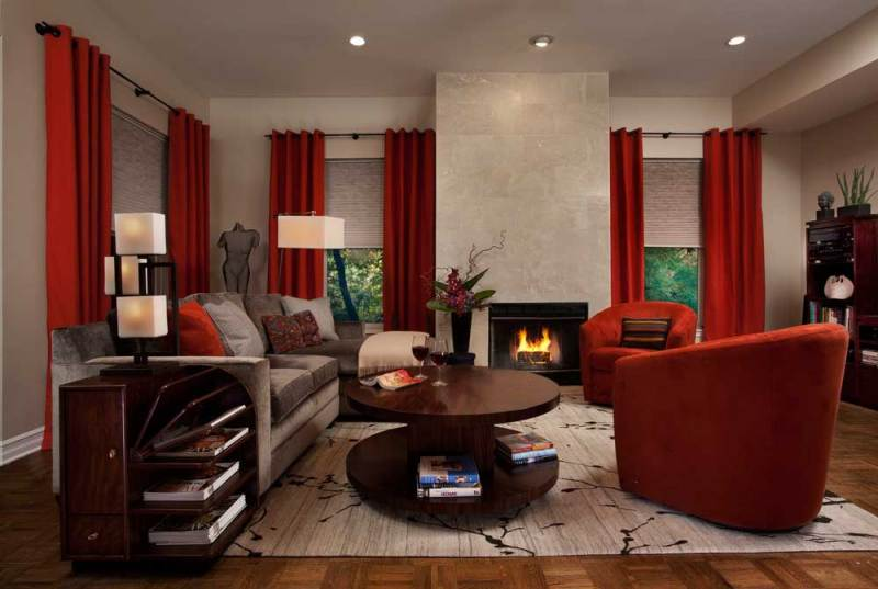 red living room with fireplace, table lamps and recessed lighting